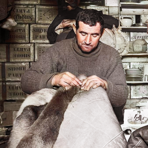 Tom Crean sewing reindeer sleeping bags whilst serving on the Terra Nova Expedition